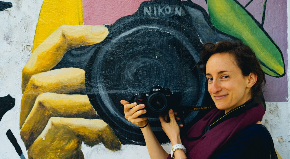 Becca with a mural at the University of Cordoba