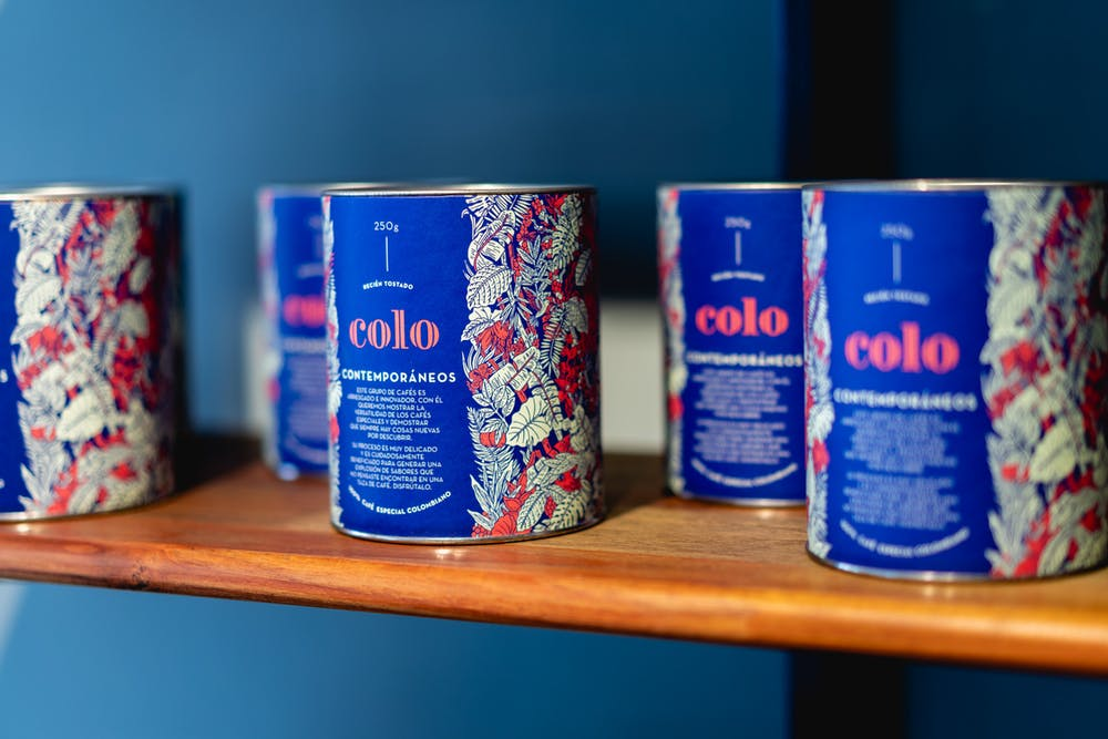 Cans of third wave coffee along the wall of a chic third wave coffeeshop in Bogota