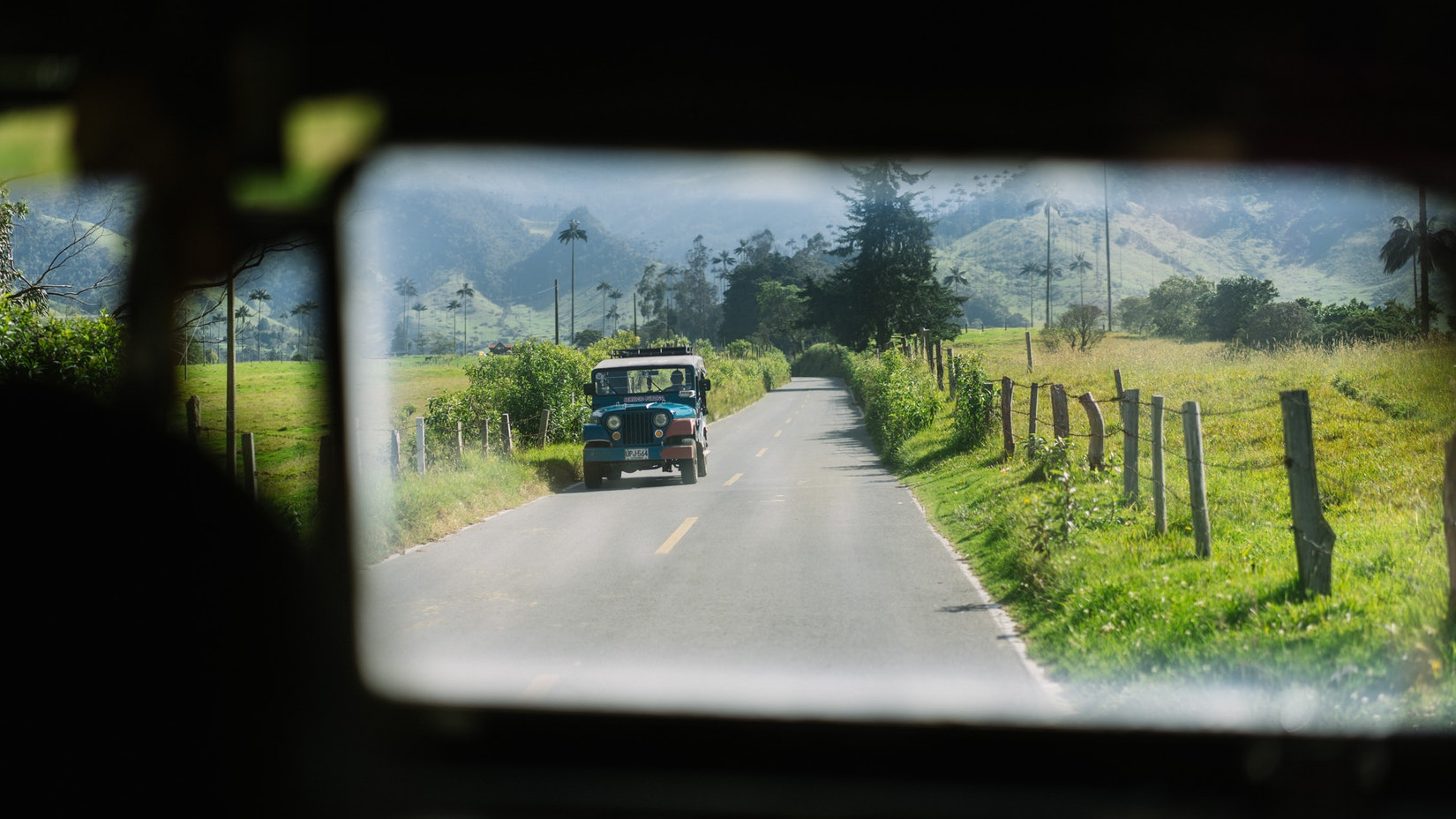 Looking at the window of a Jeep in Salento, Colombia