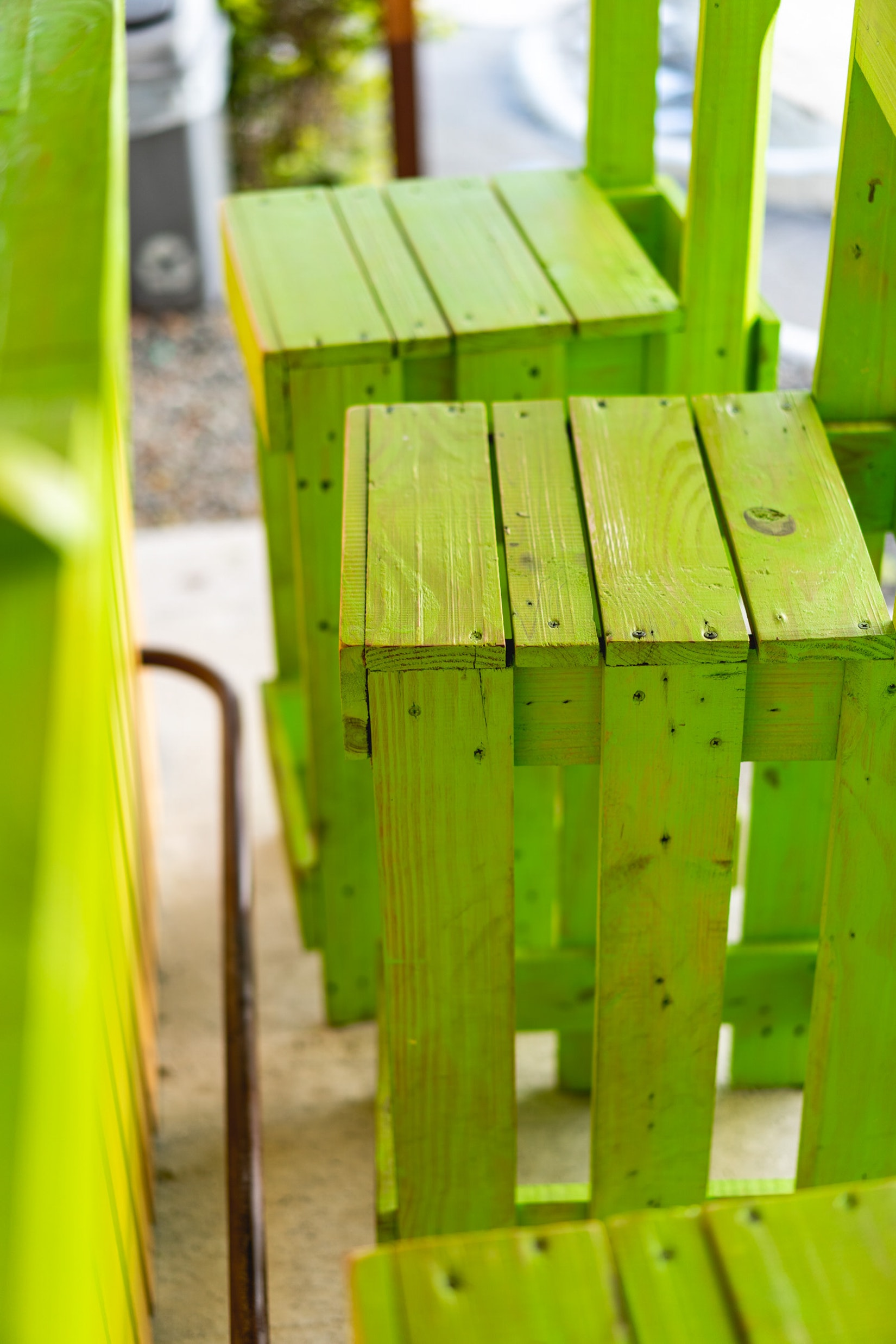 Bright lime green painted wooden bar stools
