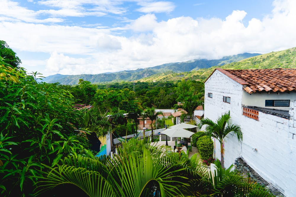 Green Nomads Hostel is the best place to stay in the mountain town of Santa Fe de Antioquia, which makes for a perfect two-day getaway from Medellin. The hostel has a lovely location on a whitewashed cobblestone street, with close access to all the historical sights to see!