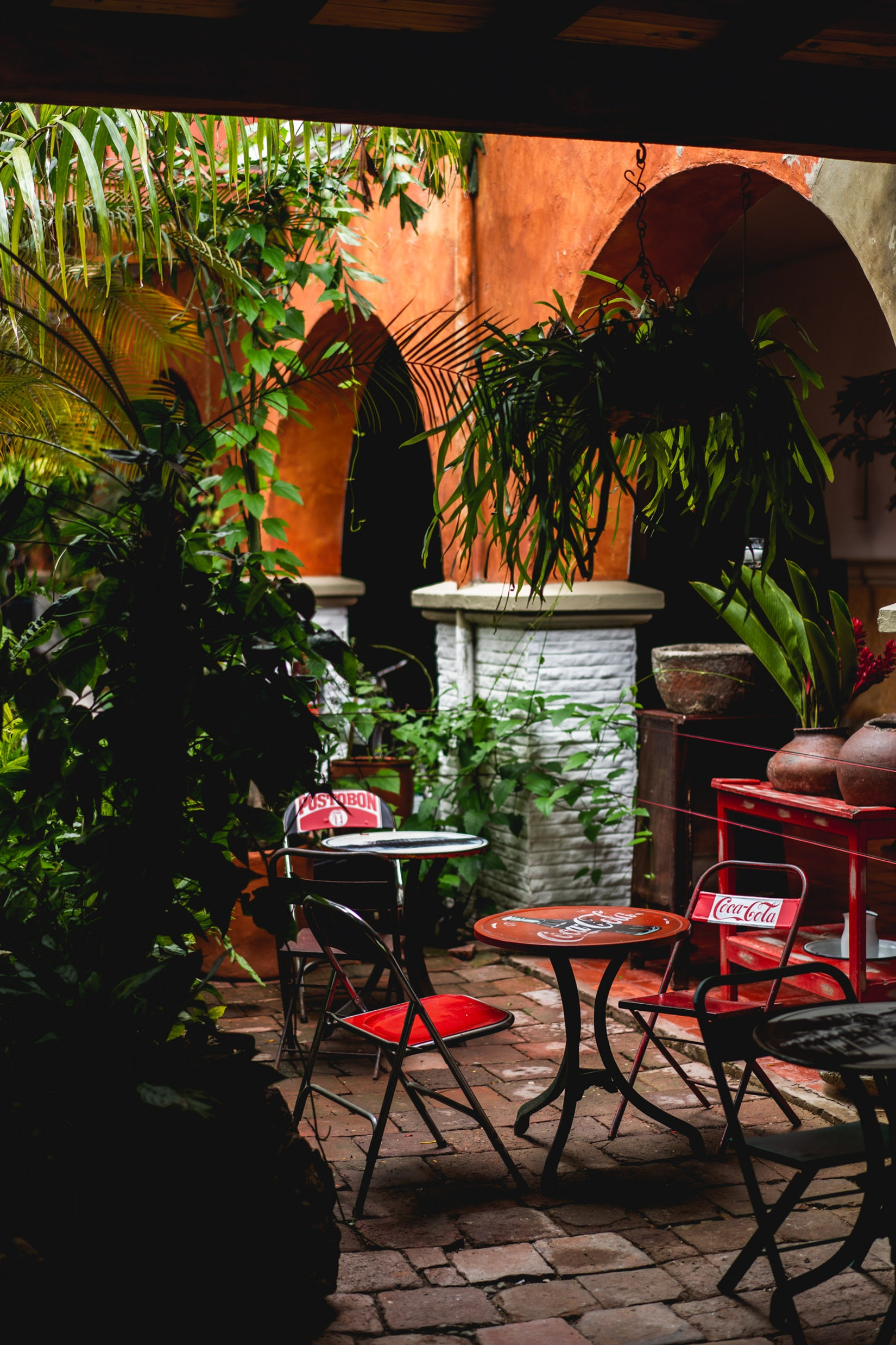 Courtyard at Hotel Mariscal Robledo with chairs and seating in an open area