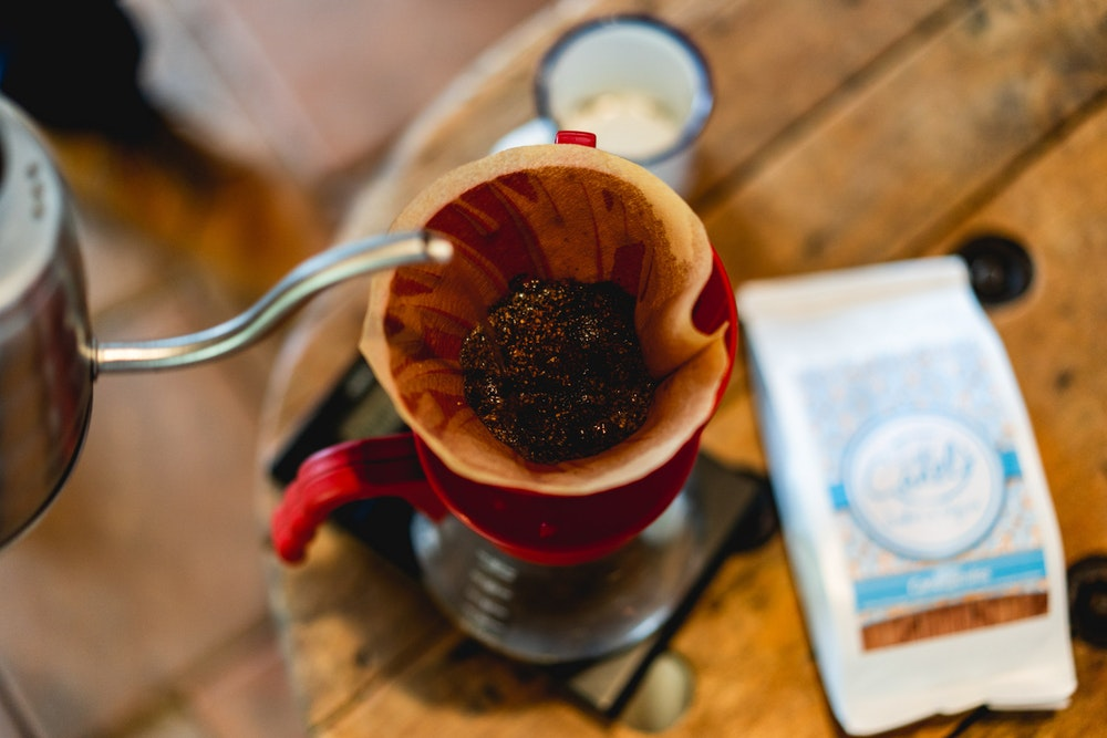 Making a pourover-style coffee at Cafe Canelo with Colombian coffee