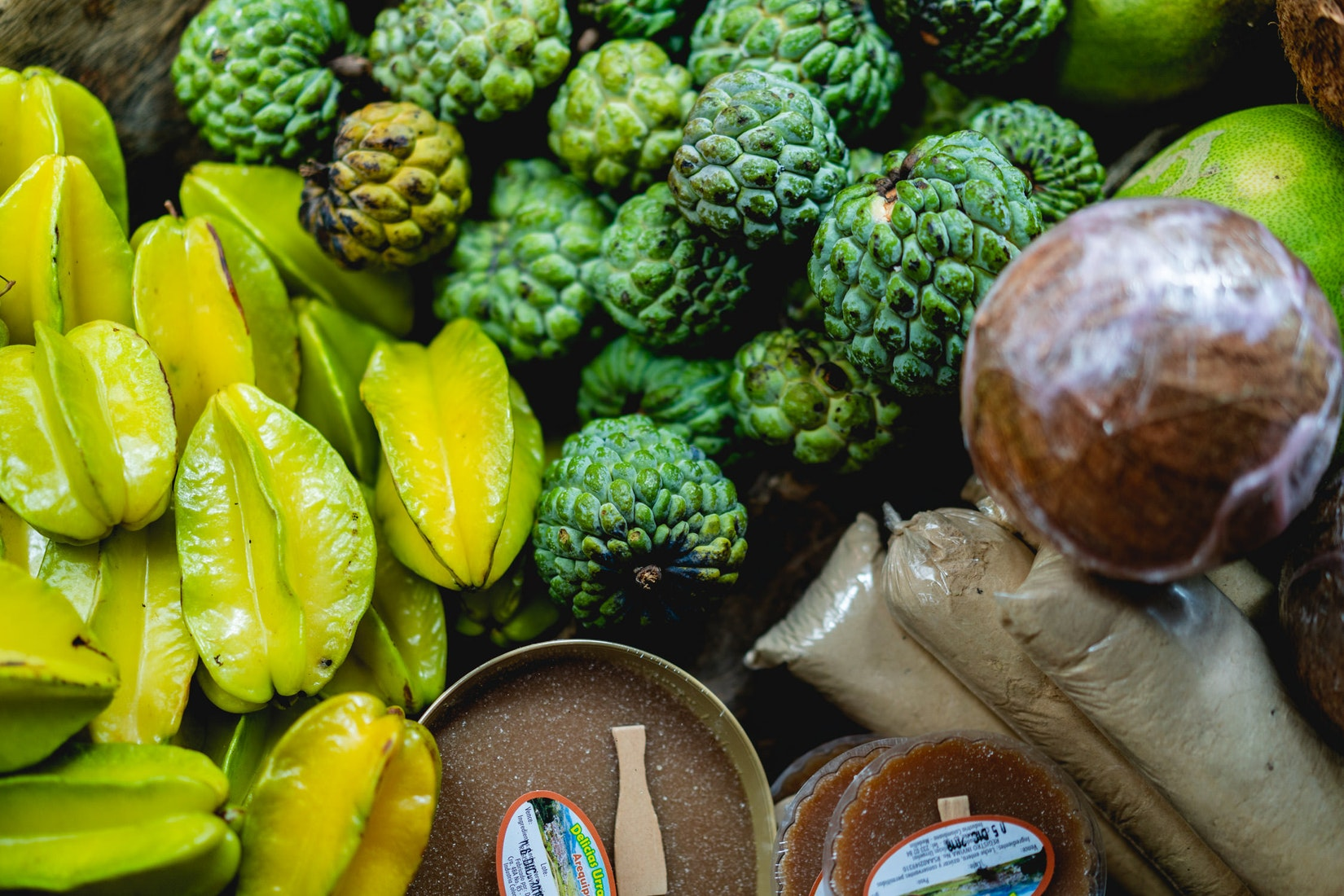 Starfruit and guanabana for sale in a Colombian market