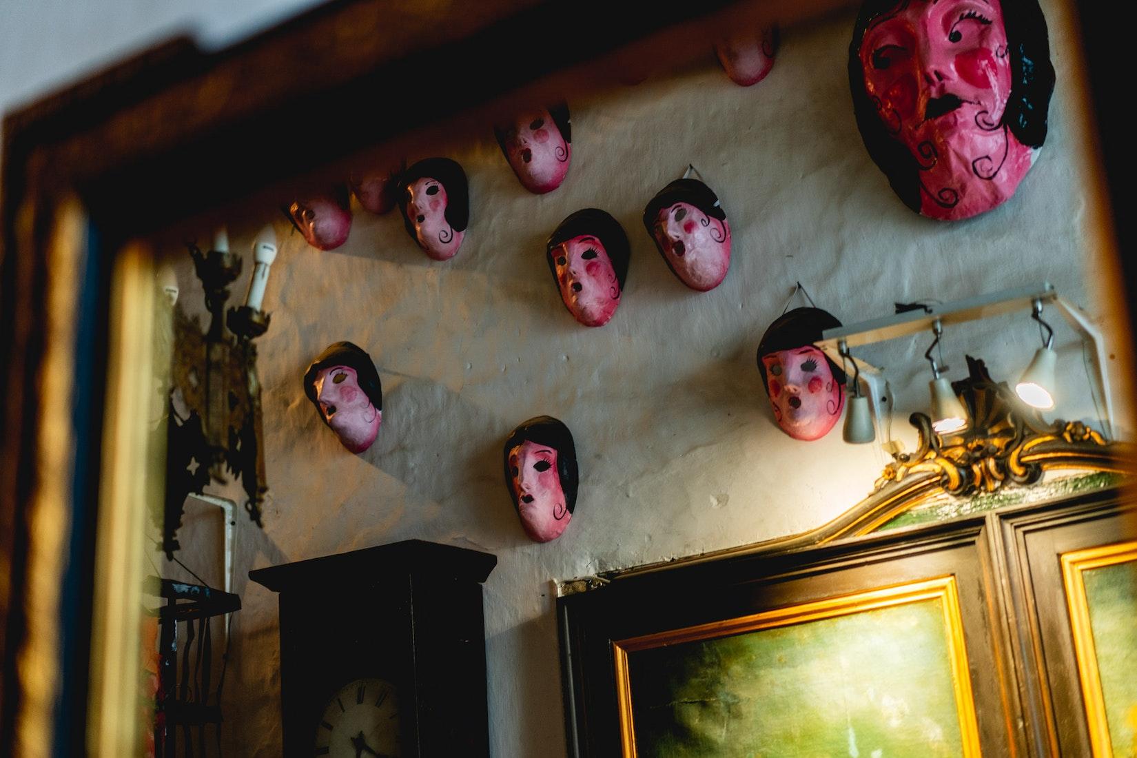 Pink masks on the wall at La Casa Solariega
