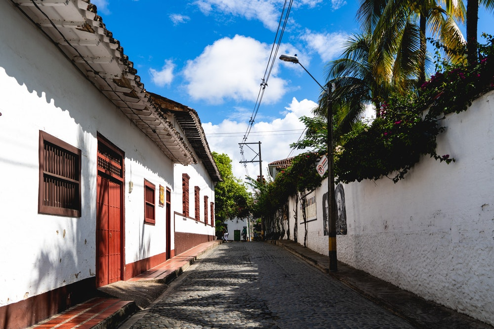 Whitewashed walls of colonial town with cobblestone street