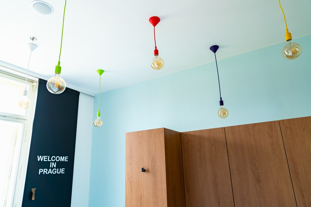 Lights hanging from the ceiling in a Meetme23 room interior