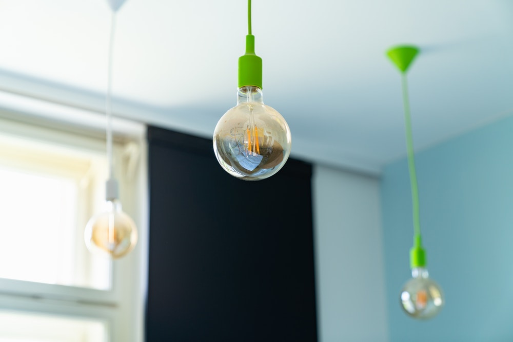 Close-up of a hanging lightbulb in a hotel room interior