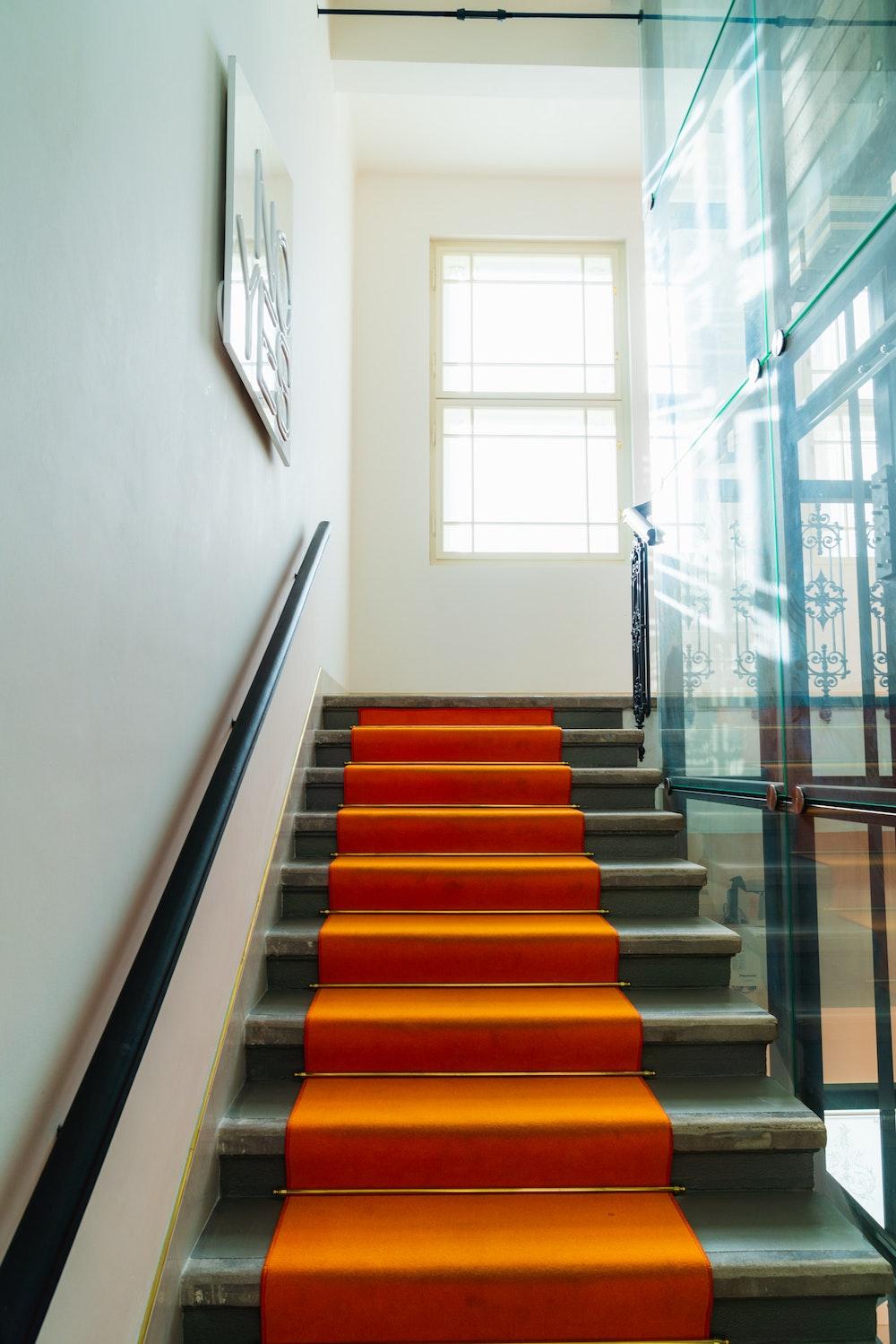 Orange carpeted steps in MeetMe23