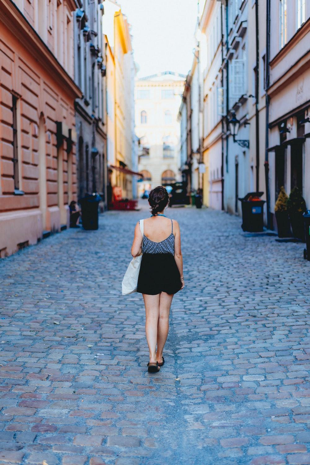 Girl walking in Prague Old Town streets