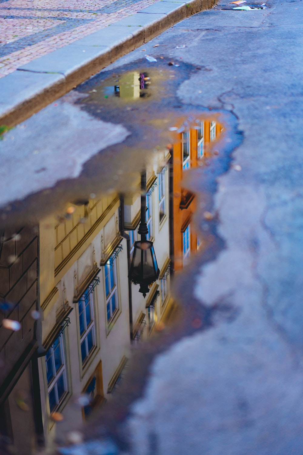 Reflection in water of Prague Old Town buildings