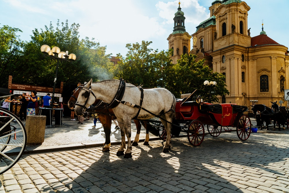 A horse-drawn carriage in Prague's Old Town Square