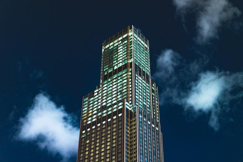 Tall building at night in Hong Kong