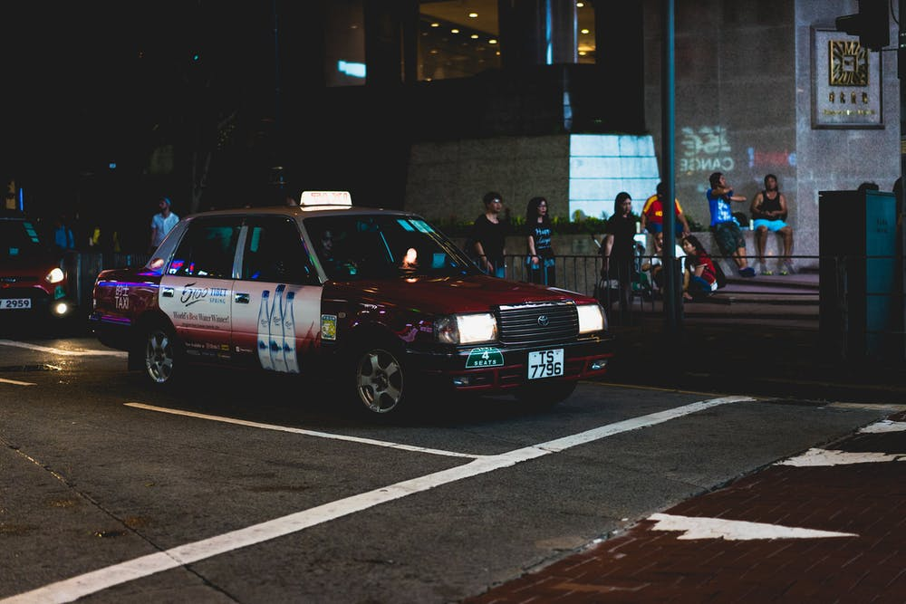 Taxi cab stopped on a street in Hong Kong