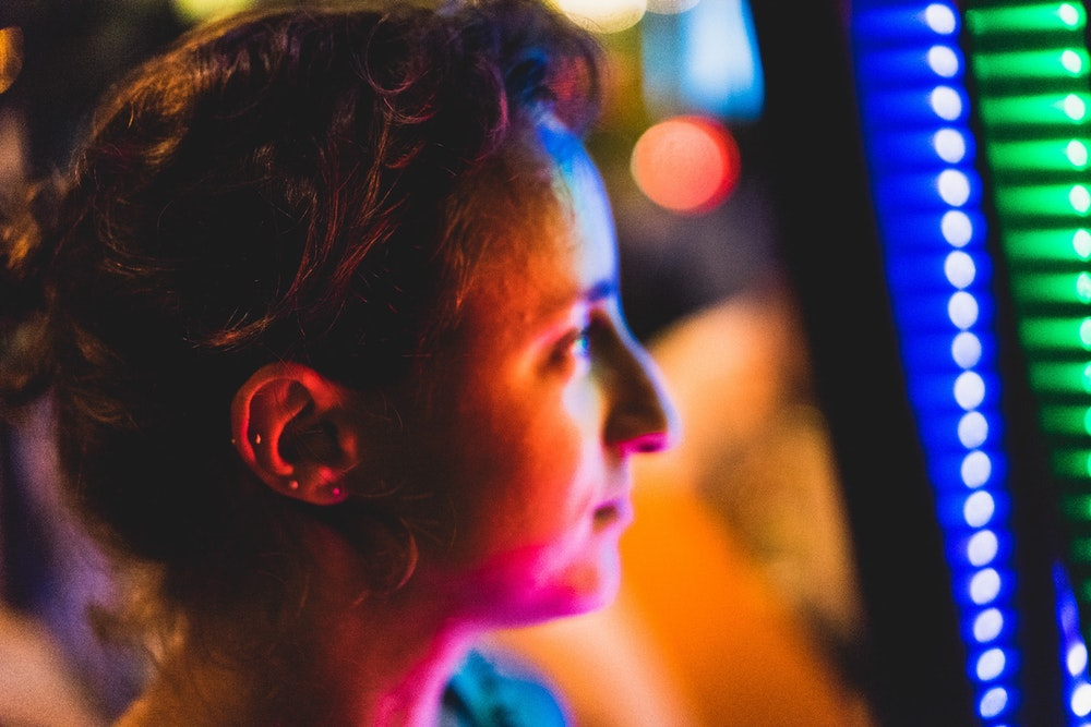Girl looking at colorful light LED strips at night