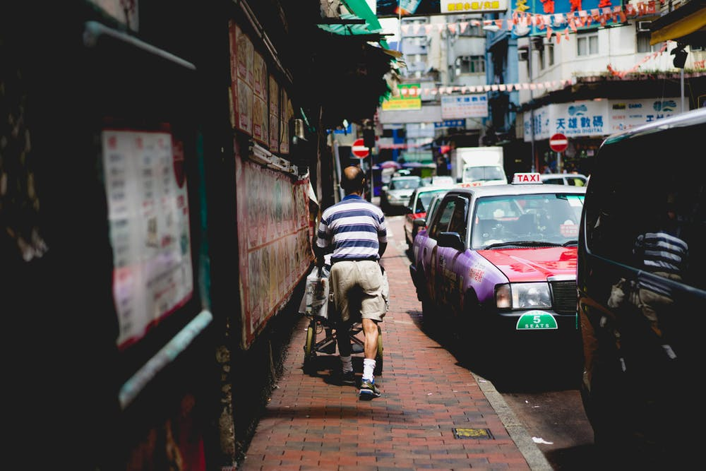 Man walking down the street in Hong Kong