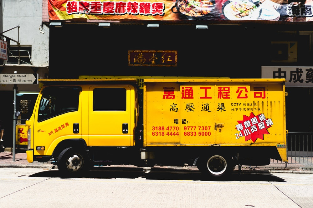 Yellow trash truck in Hong Kong