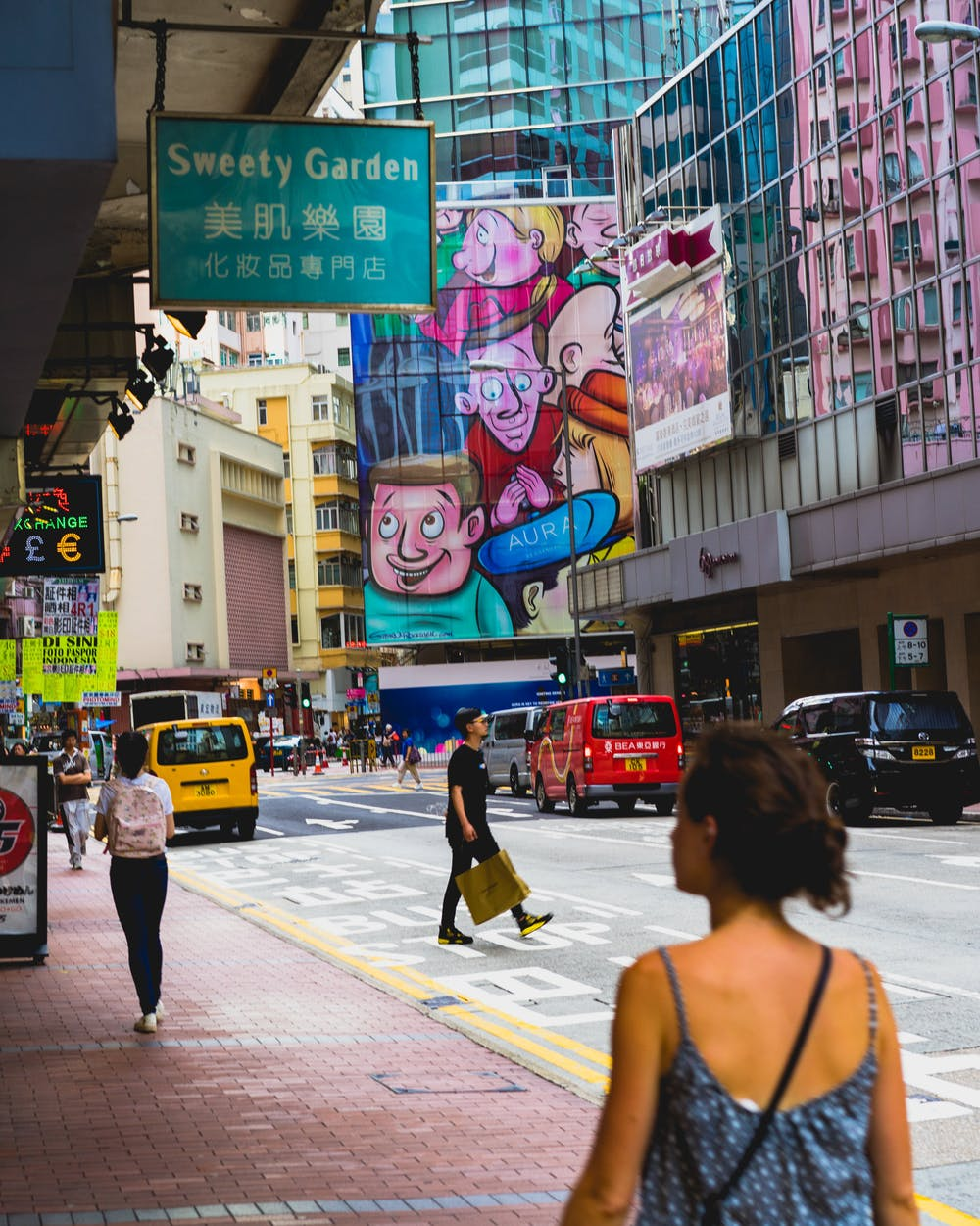 Girl walking down the street in Hong Kong