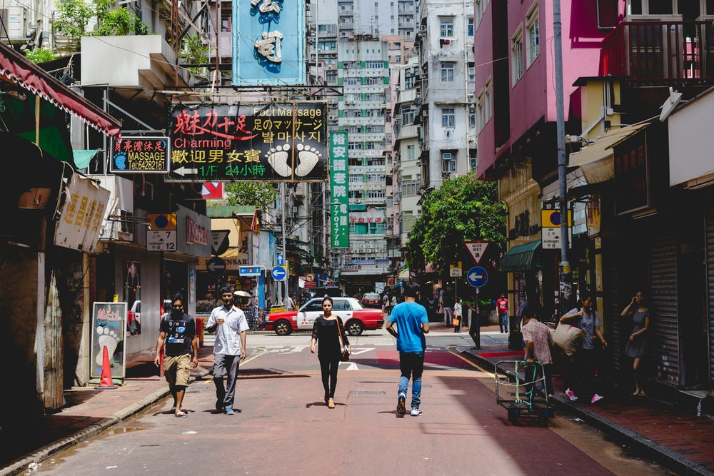 People walking down a street in Hong Kong