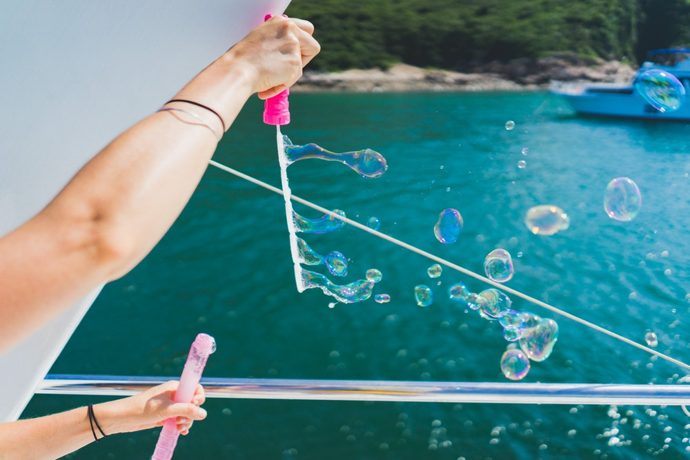 Blowing bubbles on a boat in the ocean
