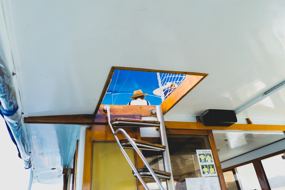 The skylight of a junk boat with a girl on the roof