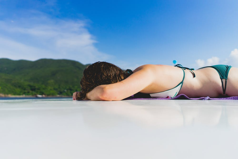 Girl sleeping on a junk boat in Hong Kong