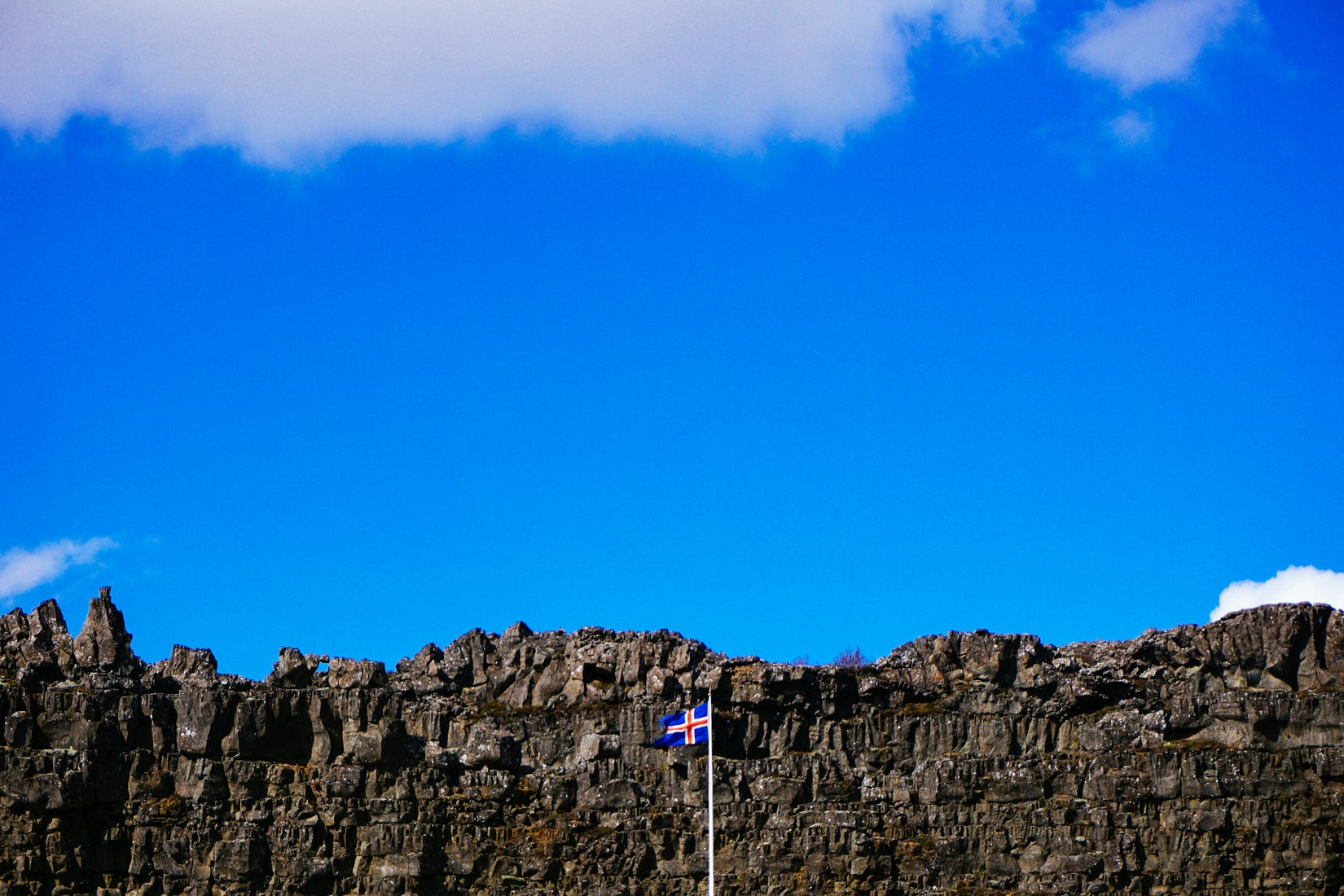 Blue sky with the Icelandic flag