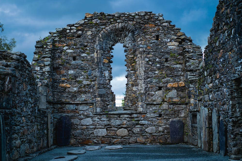 Glendalough is one of the most popular day trips for visitors to Dublin, and one of the most famous monastic sites in all of Ireland. Feeling like we were on a movie set, we walked through an ancient cemetery at dusk and felt transported to another time.