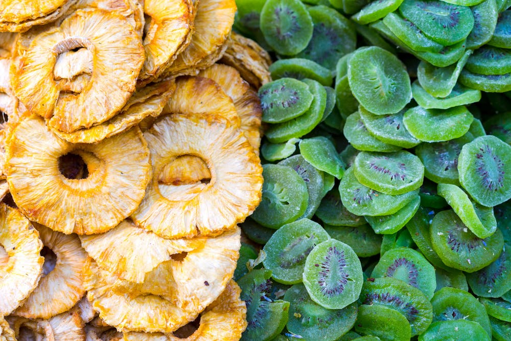 Dried sweet pineapple and dried kiwi fruit vendor shuk carmel tel aviv israel