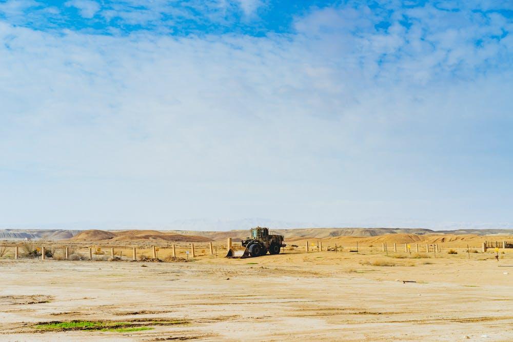 Tractor in a desert scene in the israeli negev desert israel
