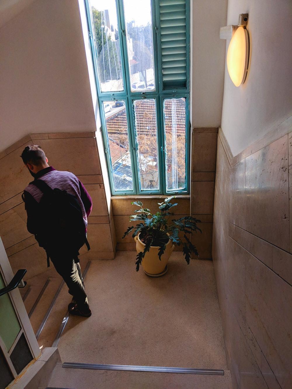 Dan walking down the steps at Abraham Hostel in Jerusalem