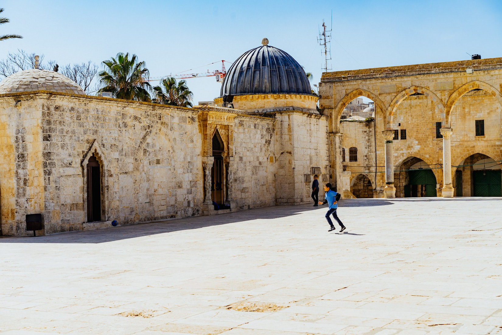 A boy playing ball at the Dome of the Rock in Jerusalem, Israel