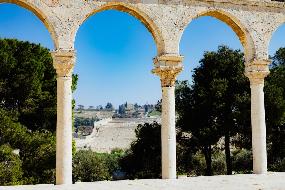 Stone columns framing trees at the Dome of the Rock in Jerusalem, Israel