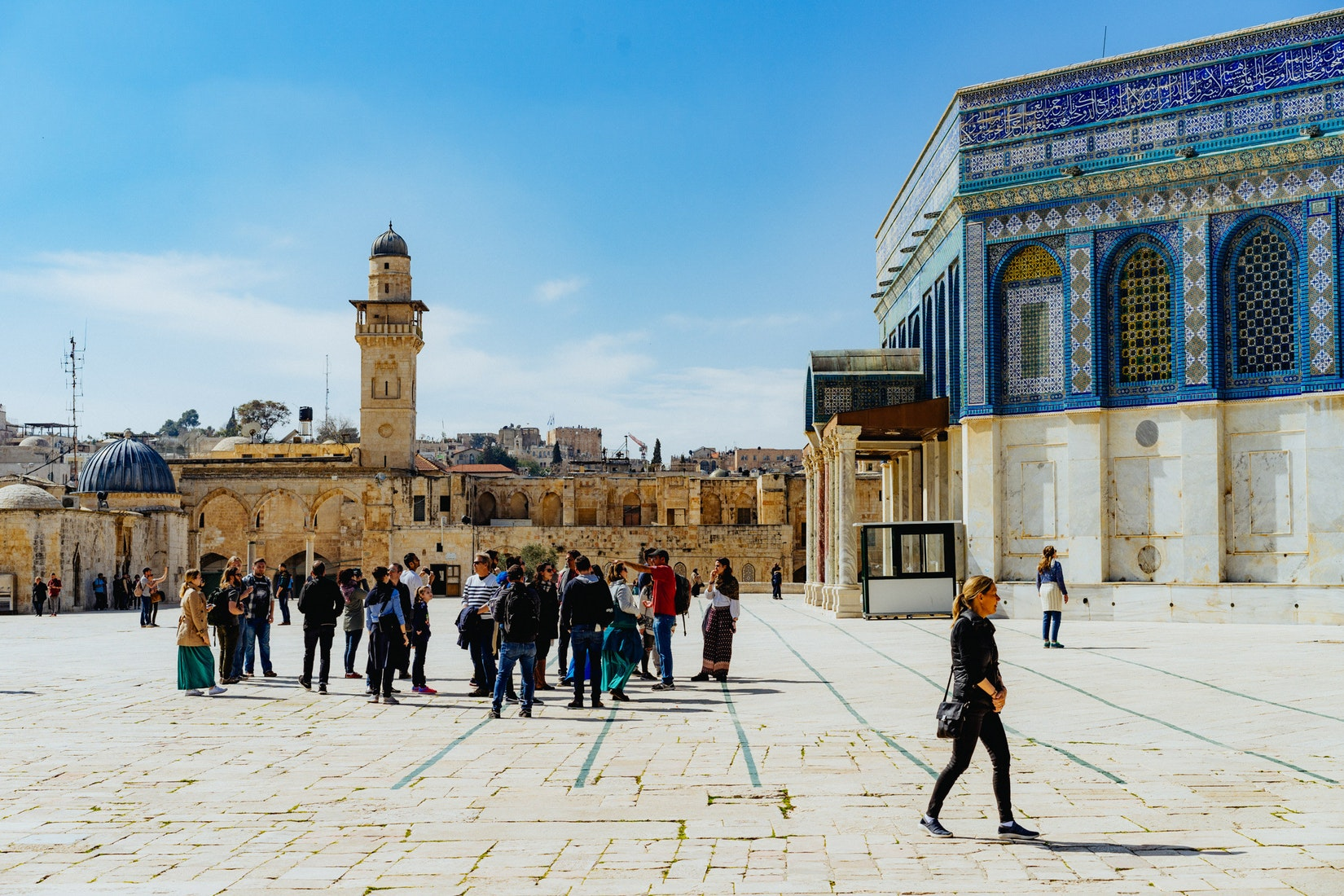 People gathering in the sun at the Dome of the Rock in Jerusalem, Israel