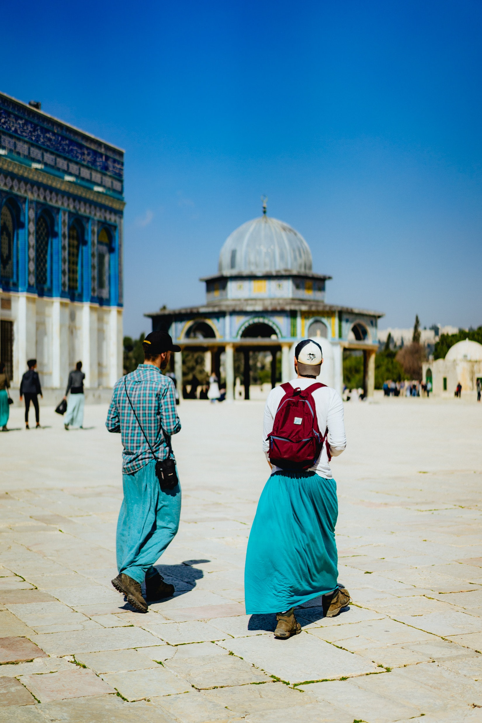 Tourists wearing teal rental skirts at the Dome of the Rock in Jerusalem, Israel