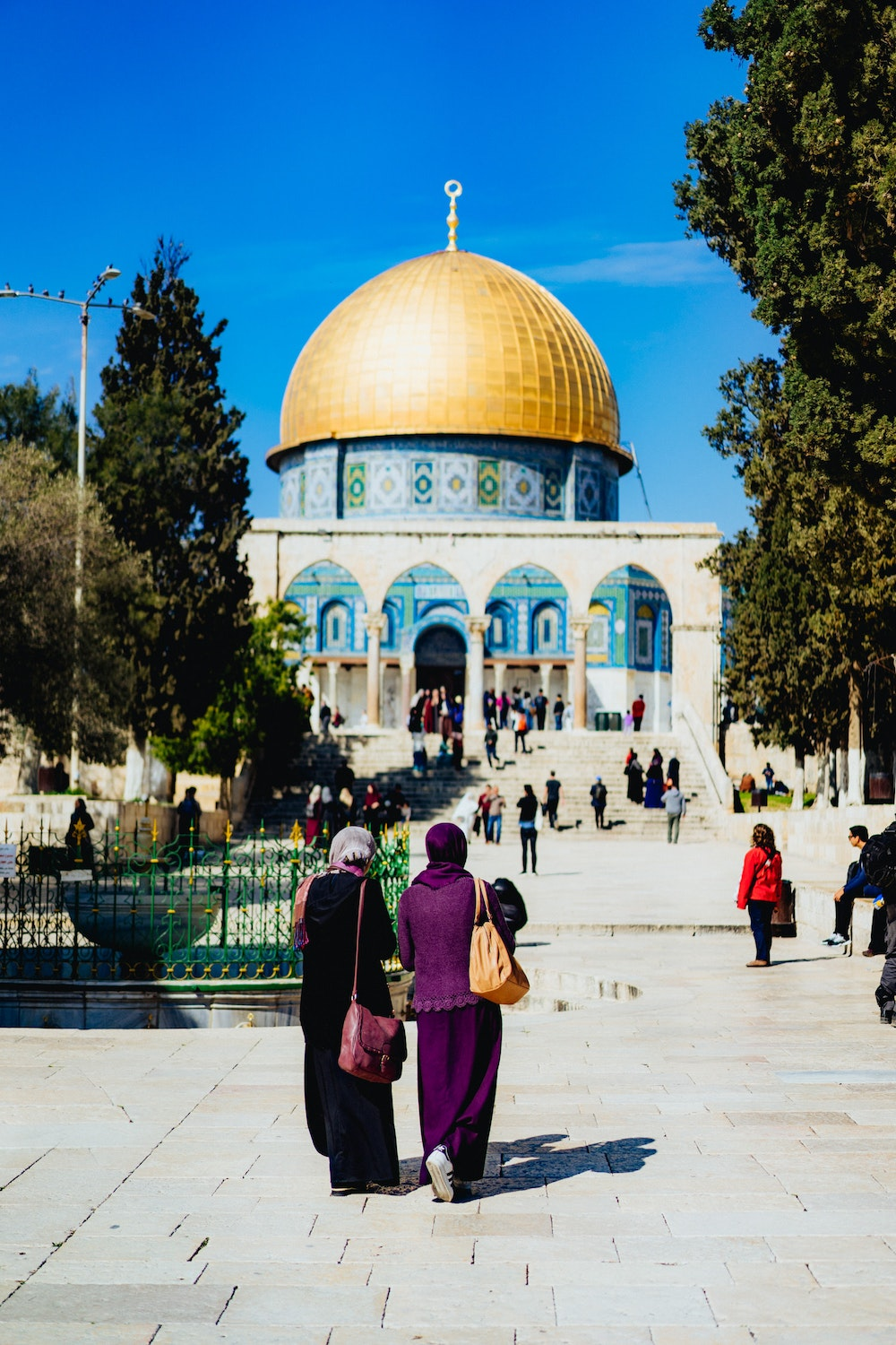 Two Muslim women walking together at the Dome of the Rock in Jerusalem, Israel