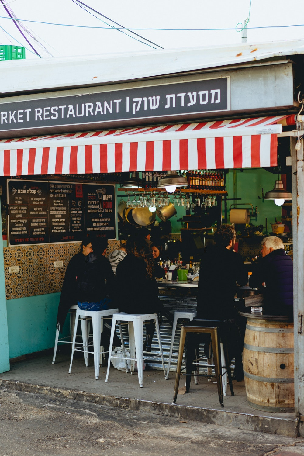 People eating at a market restaurat in Tel Aviv, Israel