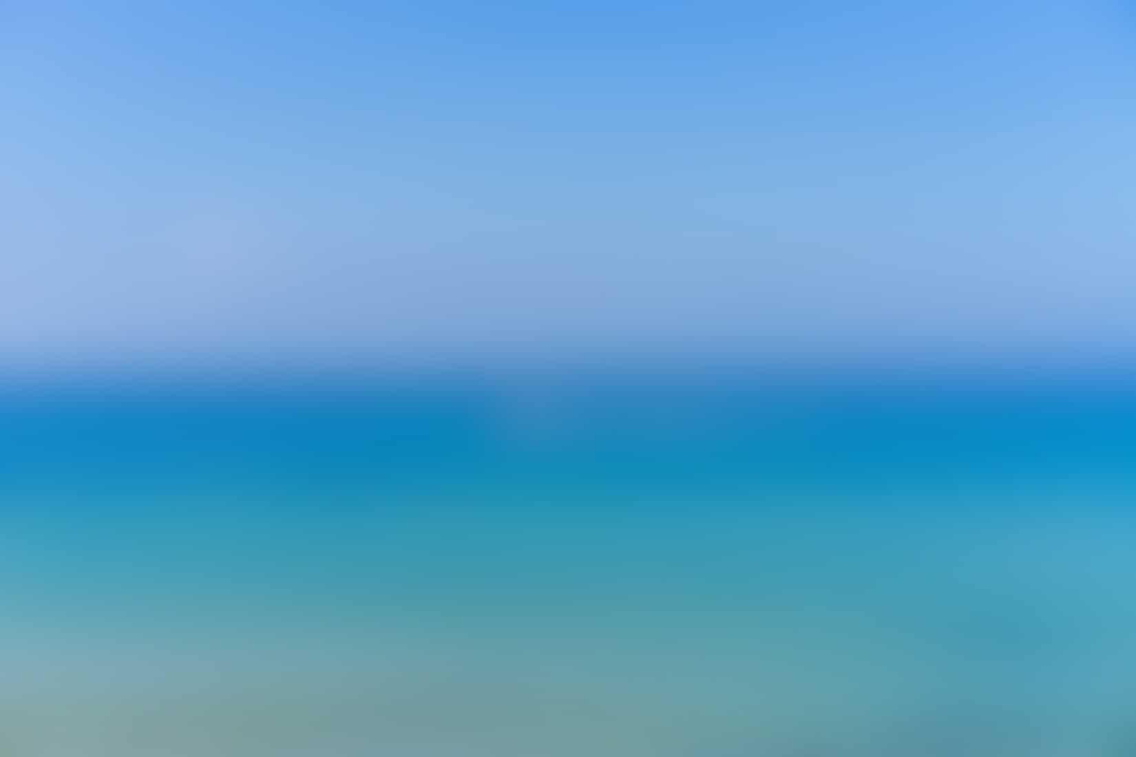 Teal and blue water in the Mediterranean beach in Tel Aviv, Israel