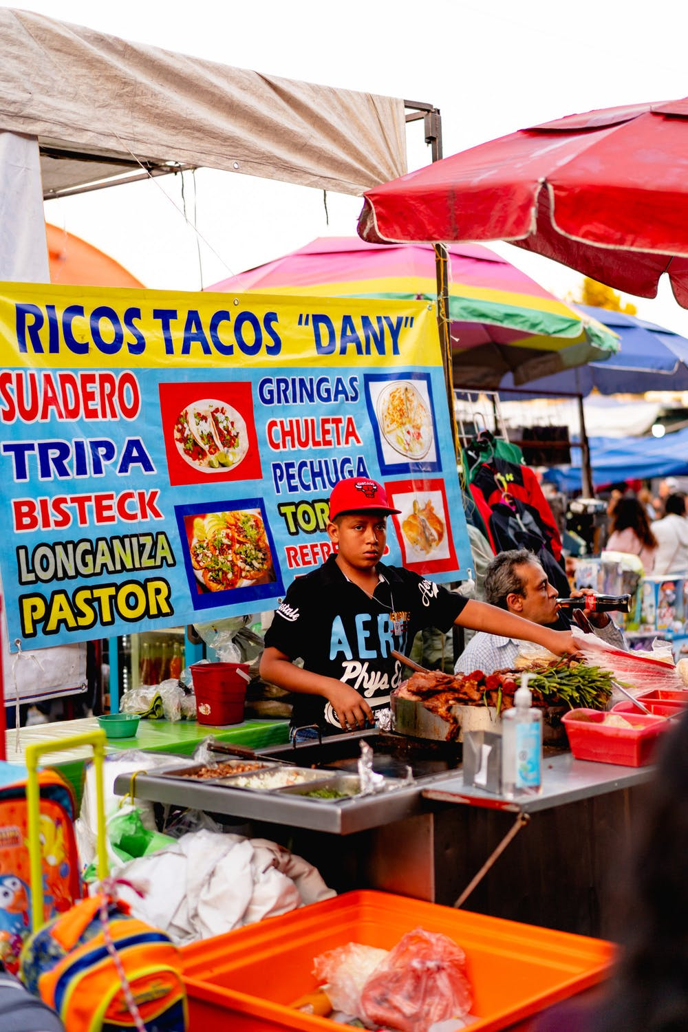 Mexican street food vendor selling ricos tacos at a Mexico City market