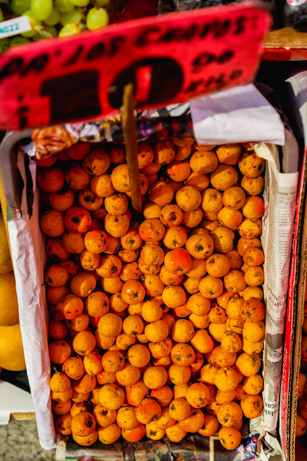 Basket of tiny mandarin citrus fruits for sale from a vendor at a Mexico City market