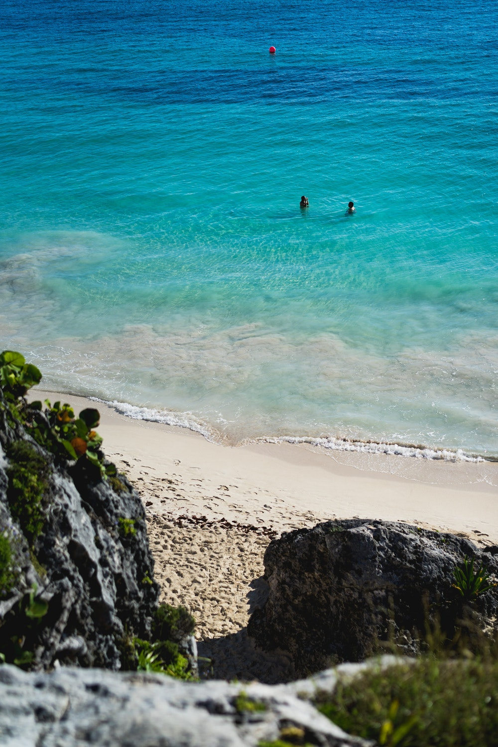 People swimming at the beach in the Tulum Ruins