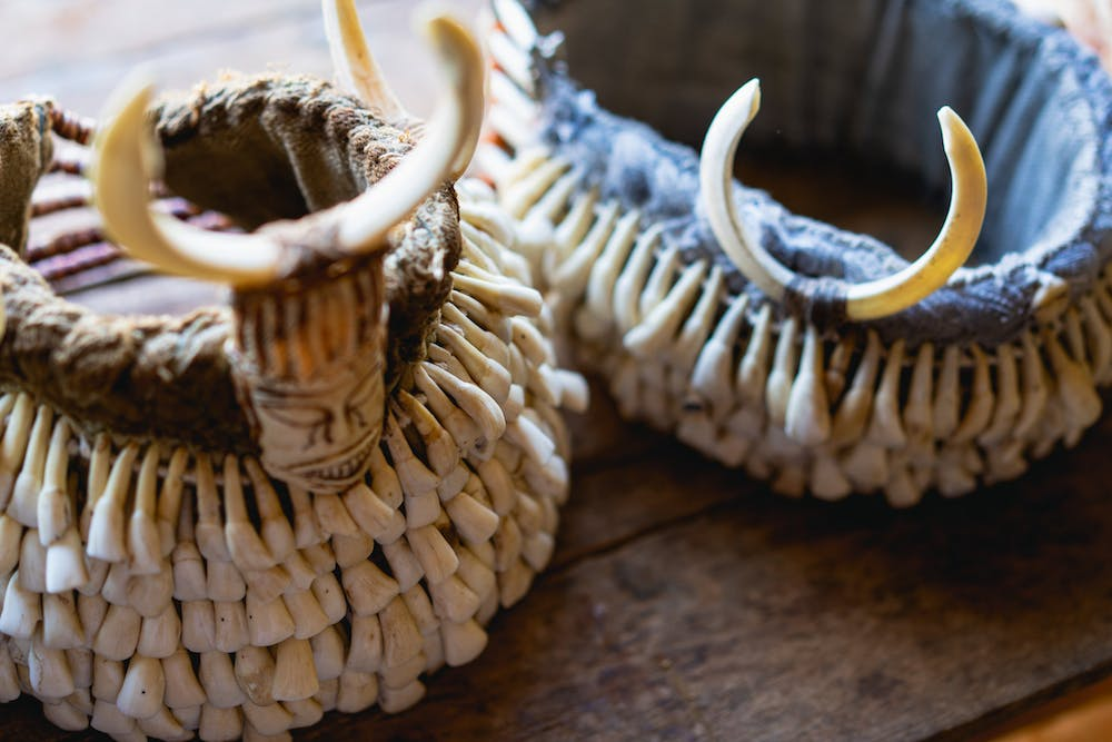 Handmade baskets made from horn and animal teeth for sale at a village market in Indein Myanmar