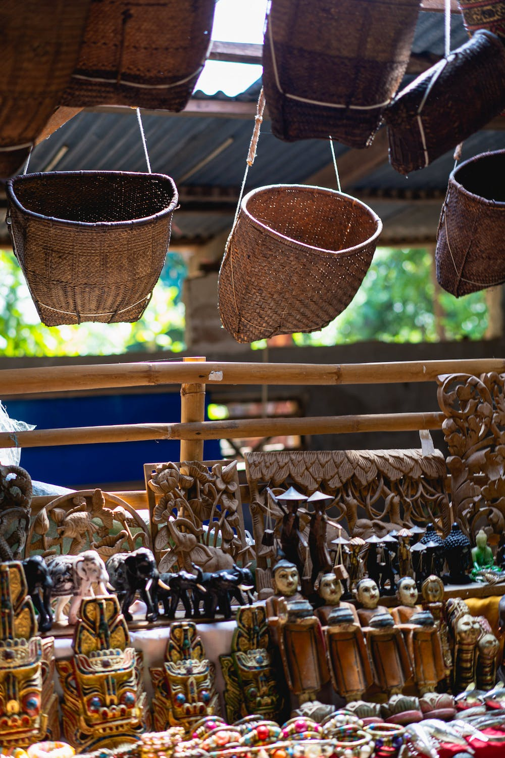 Handmade painted goods and souvenirs for sale at a vendor stall in the village market of Indein Myanmar