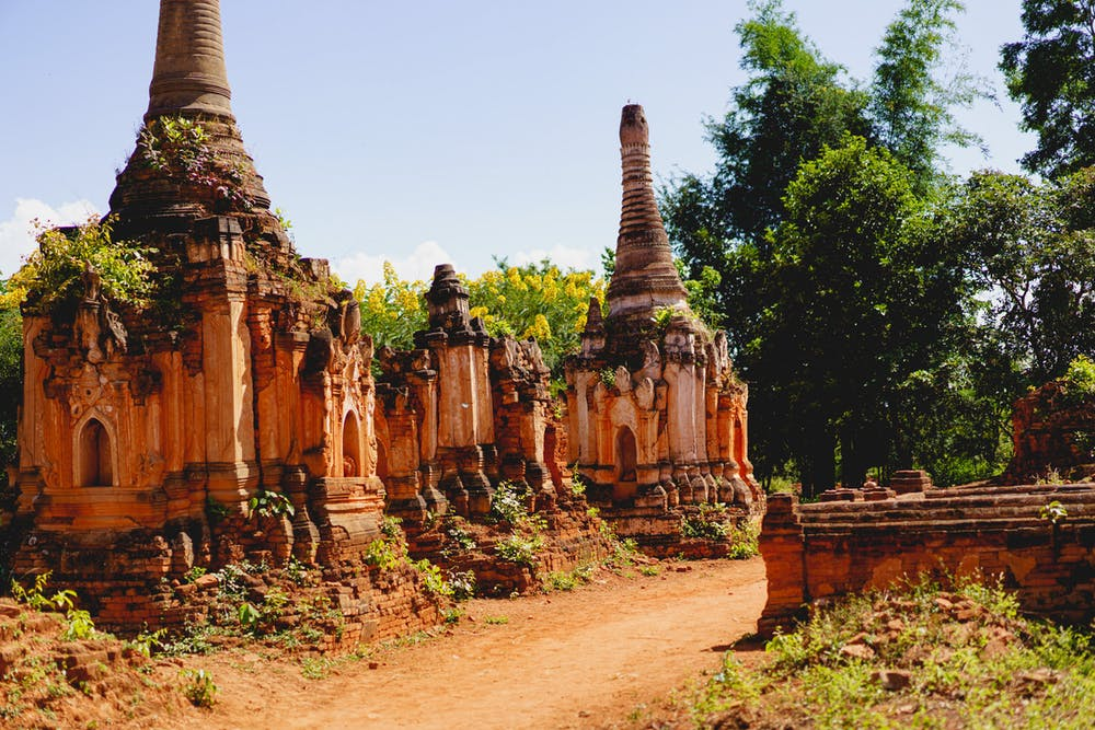 Aged and crumbling Buddhist stone stupas and pagodas in the village of Indein Myanmar