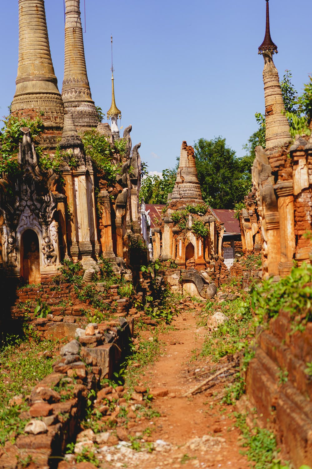 Ancient area of Buddhist stupas and pagodas on a clear hot sunny day in Indein Myanmar