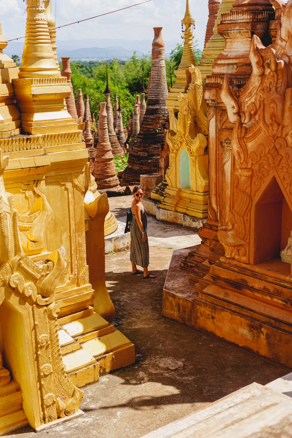 Girl in a dress among the golden stupas outside Indein Pagoda in Indein Myanmar