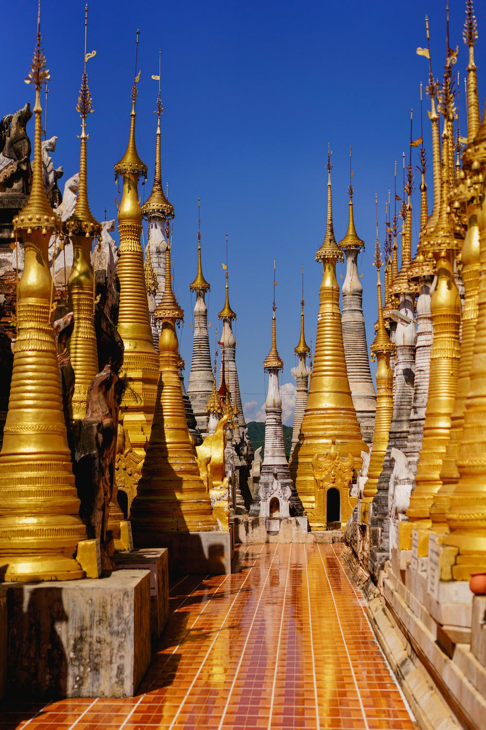 Gold stupas at the Indein Pagoda on a sunny clear day at the village Buddhist temple