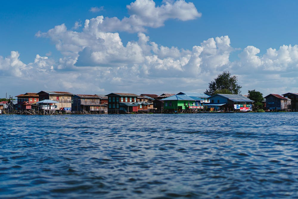 Burmese lake village homes made of wood along the waterways of Inle Lake Myanmar
