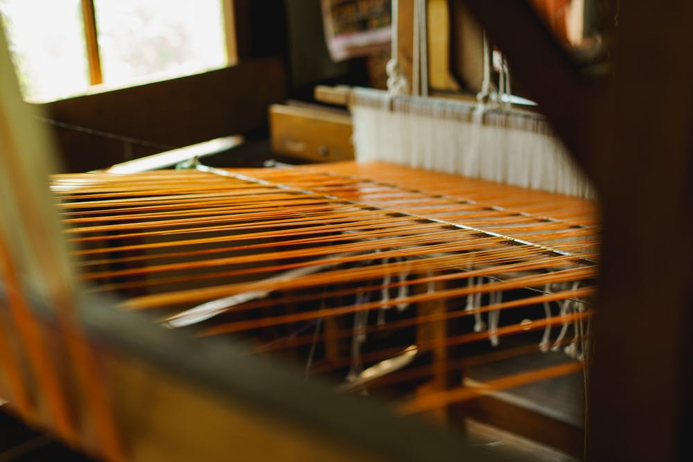 Rows of a Burmese traditional manual silk loom during the boat tour stops at Inle Lake Myanmar