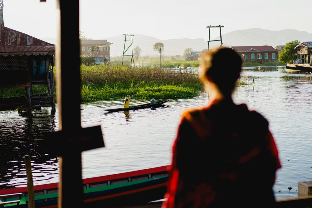 Girl looking into the river at a Burmese silk factory at Inle Lake Myanmar
